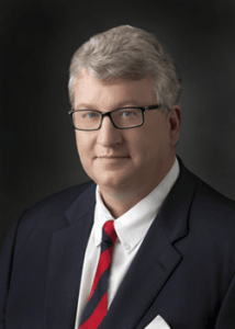 Tom Gagne is a former federal prosecutor with the Army JAG corps